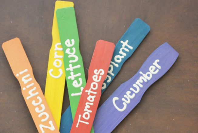 Painted paint stirrers as garden markers