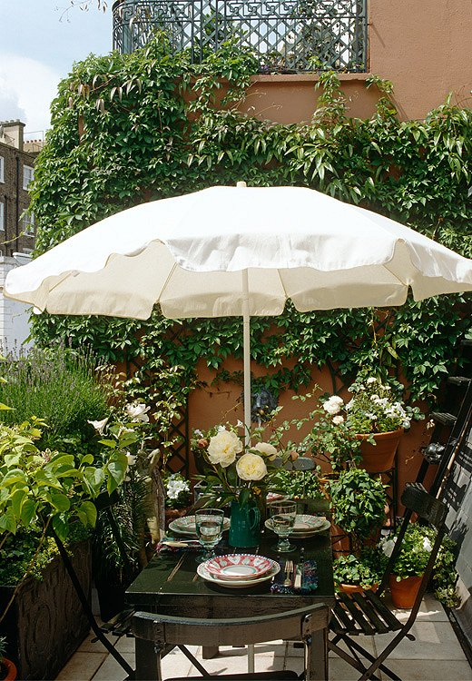Photo by Tim Beddow - The Interior Archive small urban garden outdoor dining
