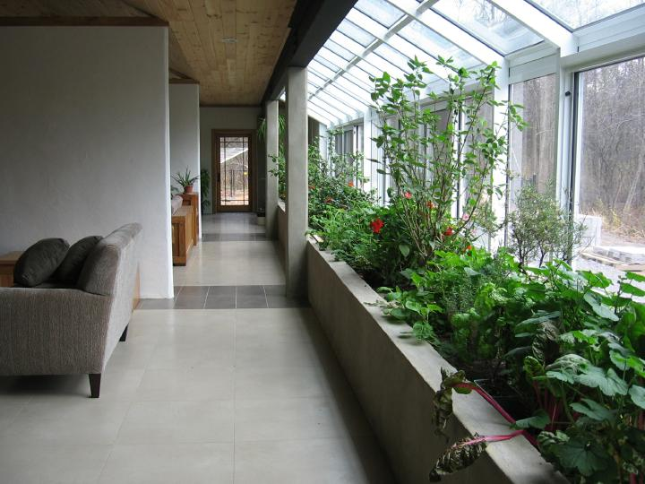 Interior planterbeds are typically above grade to minimize construction costs and optimize access
