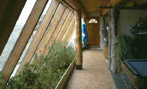 This is an interior planterbed with both roof gutter and greywater recycling, passive, sustainable irrigation systems.